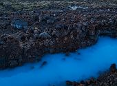 A Lava Landscape With The Water Of The Blue Lagoon In Iceland poster