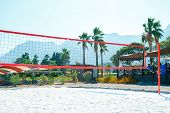 Volleyball Net And Tropical Background On Beach. Beach Volleyball. poster