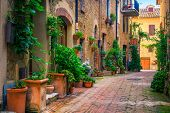 Admirable Traditional Tuscany Street View. Spectacular Medieval Stone Houses And Narrow Cute Paved S poster