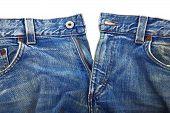 unbuttoned blue jeans