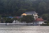 Sri Dalada Maligawa Or The Temple Of The Sacred Tooth Relic Is A Buddhist Temple In The City Of Kand poster