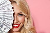 Image closeup of adorable seductive woman wearing red lipstick smiling while holding cash money at h poster