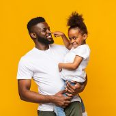 Beep. Playful African Girl Playing With Daddy, Pushing His Nose Like Signal, Orange Background poster