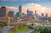 Atlanta, Georgia, USA downtown city skyline over highways at dusk. poster