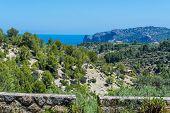 Wild West Coastline Of Mallorca, Spain In The Background The Mediterranean Sea. poster