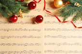 Flat Lay Composition With Christmas Decorations On Music Sheets poster