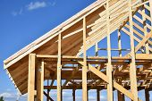 Wood Frame Residential Building Under Construction.building Construction, Wood Framing Structure At  poster