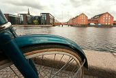 Cycle Near River And Cityscape Background Of Copenhagen, Denmark. Danish Capital At Autumn. poster