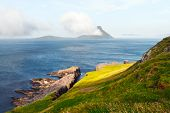 Morning view onto the Faroese island Koltur with spectacular clouds and blue water in a dramatic val poster
