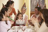 Family birthday party for Hispanic girl