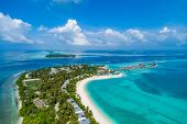 Aerial View Of Beautiful Island At Maldives In The Indian Ocean. Top View From Drone. poster