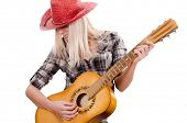 The beautiful girl in a cowboy's hat whith acoustic guitar