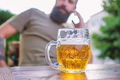Drinking From A Mug To Keep Things Firmly In Hand. Beer Mug. Serving Chilled Beer In Glass Mug In Pu poster