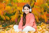Kid Girl Relaxing Near Autumn Tree With Headphones. Music For Autumn Cozy Mood. Autumn Playlist Conc poster