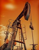 An industrial oil pump under a hot sky