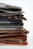 Stack Of Newspapers And Bags