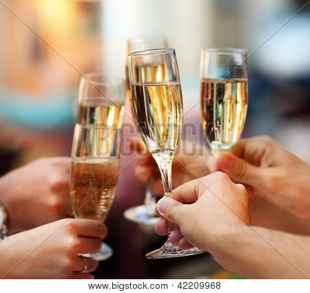 Picture or Photo of Celebration. People holding glasses of champagne making a toast