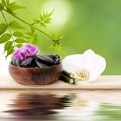 foto of reorder  - wooden bowl with stones and orchid flower with natural background - JPG