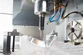 image of turn-up  - industrial metal machining cutting process of blank detail by milling cutter - JPG
