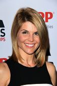 LOS ANGELES - FEB 12:  Lori Loughlin arrives at the AARP Movies for Grownups Awards Luncheon at the