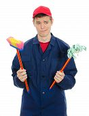 Young Male Cleaner Holding Small Brush And Mop. Isolated On White