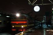 Night train comes to a railway station