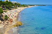 MONT-ROIG DEL CAMP, SPAIN - AUGUST 10: Vacationers in Miami Platja beaches on August 10, 2012 in Mon