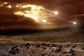stock photo of meteor  - Some meteors rain from the sky through clouds - JPG
