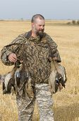 pic of pintail  - Waterfowl hunter with a mixed bag of ducks - JPG