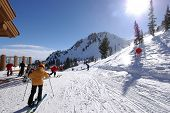 stock photo of family ski vacation  - ski resort on a sunny day - JPG