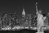 stock photo of statue liberty  - Manhattan Skyline and The Statue of Liberty at Night - JPG