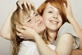 Red And Blond Haired Girls Tousle Hair