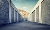 stock photo of self-storage  - many unit storage with metal rolls up - JPG
