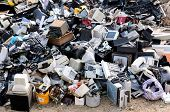 stock photo of trash truck  - Electronic waste ready for recycling on junk yard - JPG