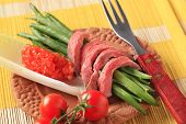 juicy roastbeef with fresh beans and red lentils