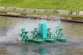 picture of aeration  - Aerator  water treatment by  paddle wheel in pond - JPG