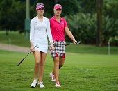 KUALA LUMPUR - OCTOBER 12: Sandra Gal (white) and Anna Nordqvist walk to the 2nd hole green of the KLGCC course on Day 3 of the Sime Darby LPGA on October 12, 2013 in Kuala Lumpur, Malaysia.