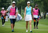 KUALA LUMPUR - OCTOBER 12: Michele Wie of USA walks with her caddy towards the 2nd hole green of the KLGCC course on Day 3 of the Sime Darby LPGA on October 12, 2013 in Kuala Lumpur, Malaysia.