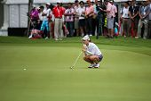 KUALA LUMPUR - OCTOBER 12: So Yeon Ryu of South Korea lines up her putt at the 2nd hole green of the