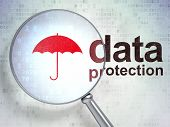 stock photo of policy  - Magnifying optical glass with Umbrella icon and Data Protection word on digital background - JPG