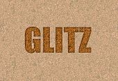 stock photo of glitz  - glitz text written in gold glitter for fun - JPG