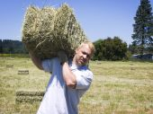 Man Lifting Hay Bale