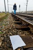 a young woman leaves a farewell letter and goes to commit suicide on a railway. letter in english