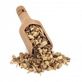 Licorice root used in chinese herbal medicine in a wooden scoop over white background. Gan cao.