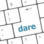 stock photo of daring  - dare word on keyboard key computer button - JPG