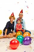 Cheerful Family At Party With Confetti