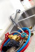 Kitchen sink pipes and drain. Plumbing service.