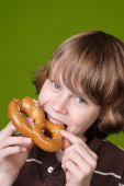 Boy Eating A Soft Pretzel poster
