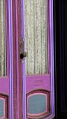 stock photo of lace-curtain  - Bright and colorful purple door of home - JPG