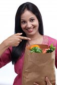 Young Indian Girl Holding Grocery Bag With Full Of Fruits And Vegetables